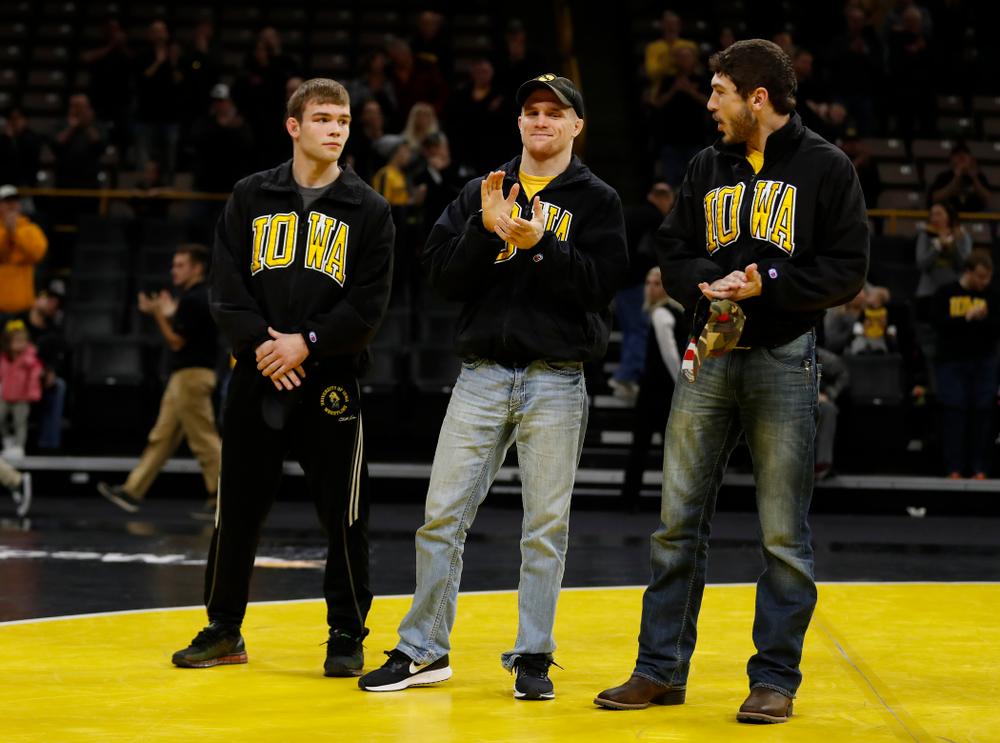 Iowa seniors Phillip Laux,  Logan McQuillen, and