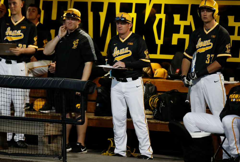 Iowa Hawkeyes associate head coach Marty Sutherland against Milwaukee Wednesday, April 25, 2018 at Duane Banks Field. (Brian Ray/hawkeyesports.com)