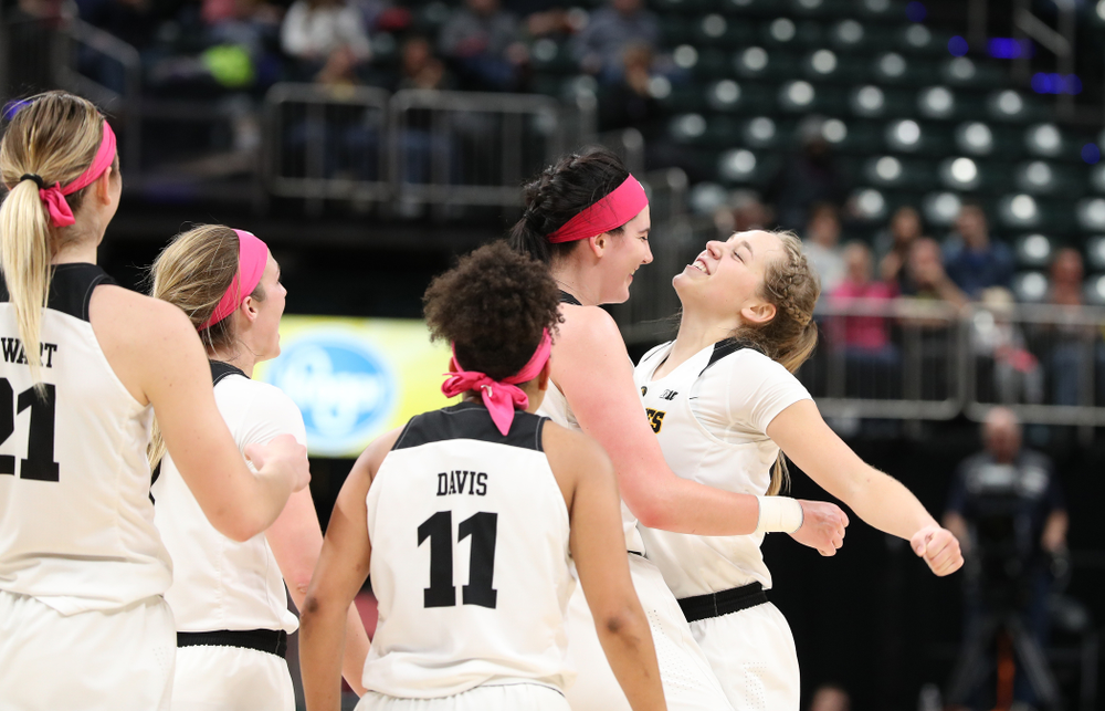 Iowa Hawkeyes forward Megan Gustafson (10) and guard Kathleen Doyle (22) against the Rutgers Scarlet Knights in the semi-finals of the Big Ten Tournament Saturday, March 9, 2019 at Bankers Life Fieldhouse in Indianapolis, Ind. (Brian Ray/hawkeyesports.com)