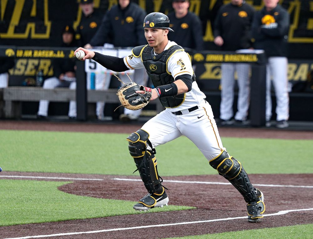 Iowa catcher Tyler Snep (16) chases a runner back to third during the sixth inning of their college baseball game at Duane Banks Field in Iowa City on Wednesday, March 11, 2020. (Stephen Mally/hawkeyesports.com)