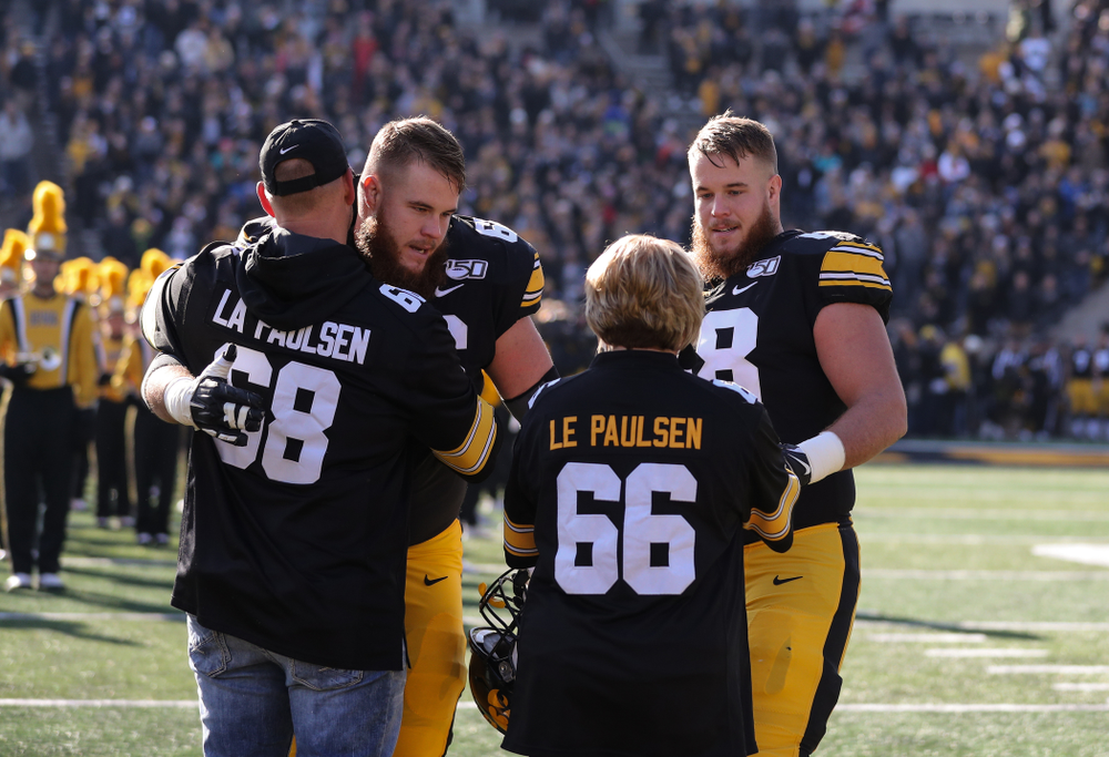 Iowa Hawkeyes offensive lineman Landan Paulsen (68) and offensive lineman Levi Paulsen (66) during Senior Day festivities before their game against the Illinois Fighting Illini Saturday, November 23, 2019 at Kinnick Stadium. (Brian Ray/hawkeyesports.com)