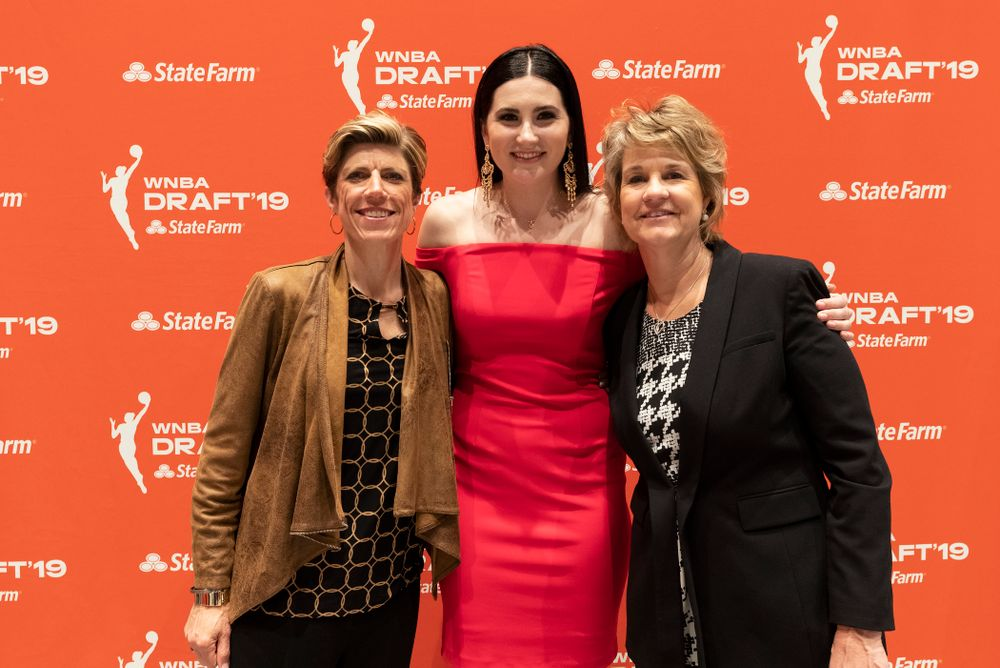 Iowa Hawkeyes forward Megan Gustafson (10) with head coach Lisa Bluder and associate head coach Jan Jensen after being selected by the Dallas Wings in the second round of the 2019 WNBA Draft Wednesday, April 10, 2019 at Nike New York Headquarters in New York City. (Brian Ray/hawkeyesports.com)