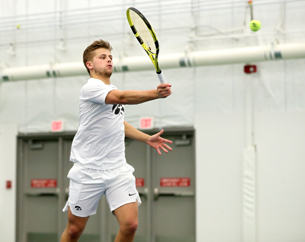 Iowa's Will Davies returns a shot during his singles match at the Hawkeye Tennis and Recreation Complex in Iowa City on Sunday, February 16, 2020. (Stephen Mally/hawkeyesports.com)