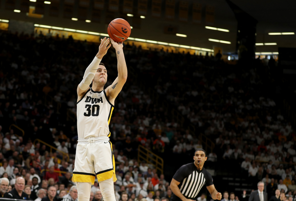 Iowa Hawkeyes guard Connor McCaffery (30) makes a three point basket against the Illinois Fighting Illini Sunday, February 2, 2020 at Carver-Hawkeye Arena. (Brian Ray/hawkeyesports.com)