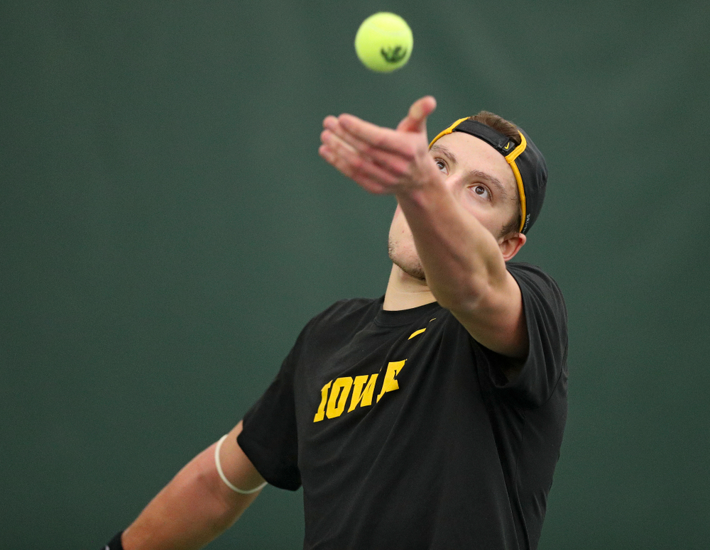 Iowa's Joe Tyler serves during his match against Marquette at the Hawkeye Tennis and Recreation Complex in Iowa City on Saturday, January 25, 2020. (Stephen Mally/hawkeyesports.com)