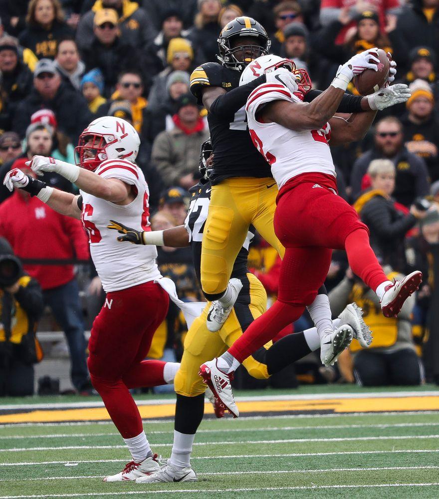 Iowa Hawkeyes defensive back Michael Ojemudia (11) breaks up a pass during a game against Nebraska at Kinnick Stadium on November 23, 2018. (Tork Mason/hawkeyesports.com)