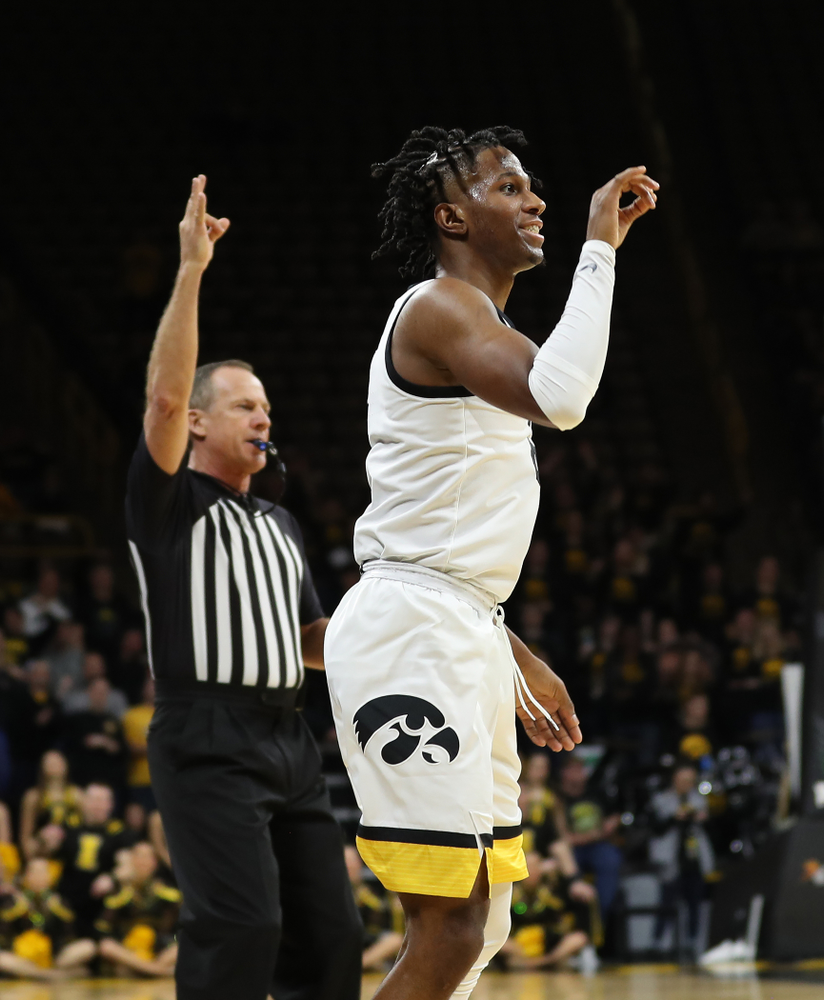Iowa Hawkeyes guard Bakari Evelyn (4) celebrates a three point basket against the Maryland Terrapins Friday, January 10, 2020 at Carver-Hawkeye Arena. (Brian Ray/hawkeyesports.com)