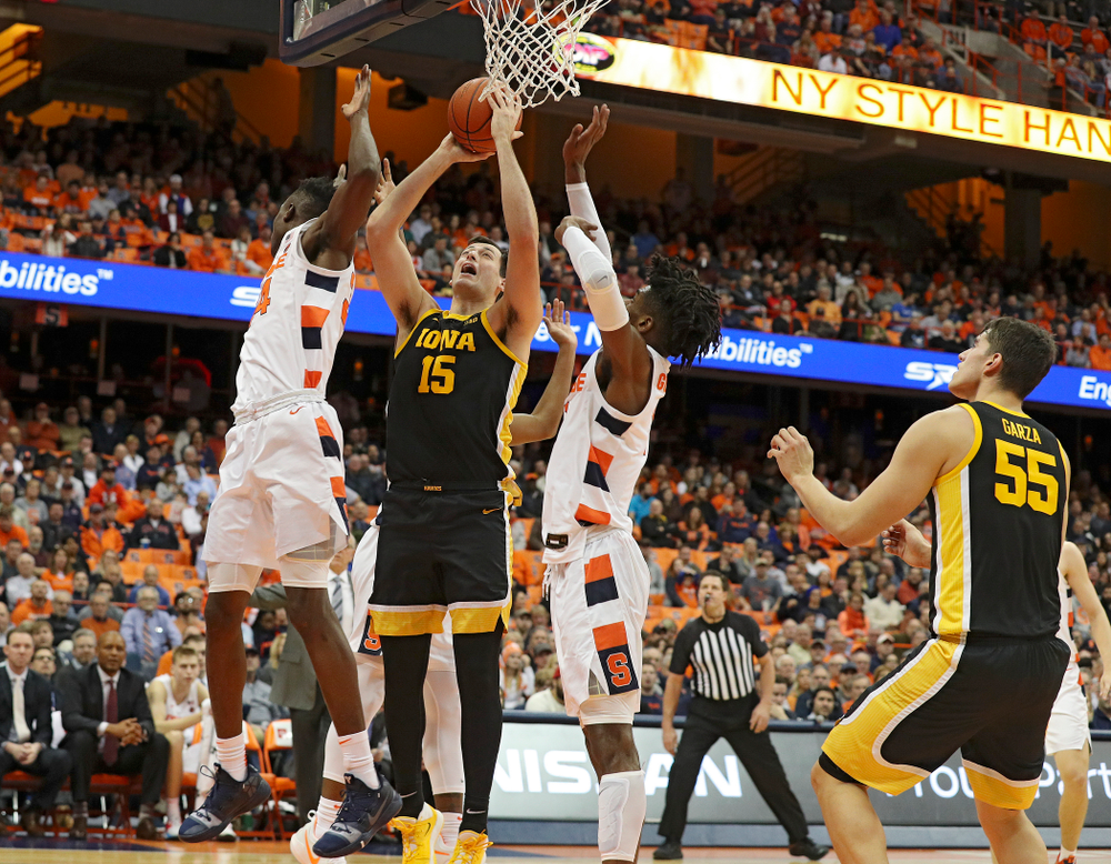 Iowa Hawkeyes forward Ryan Kriener (15) makes a basket during the first half of their ACC/Big Ten Challenge game at the Carrier Dome in Syracuse, N.Y. on Tuesday, Dec 3, 2019. (Stephen Mally/hawkeyesports.com)