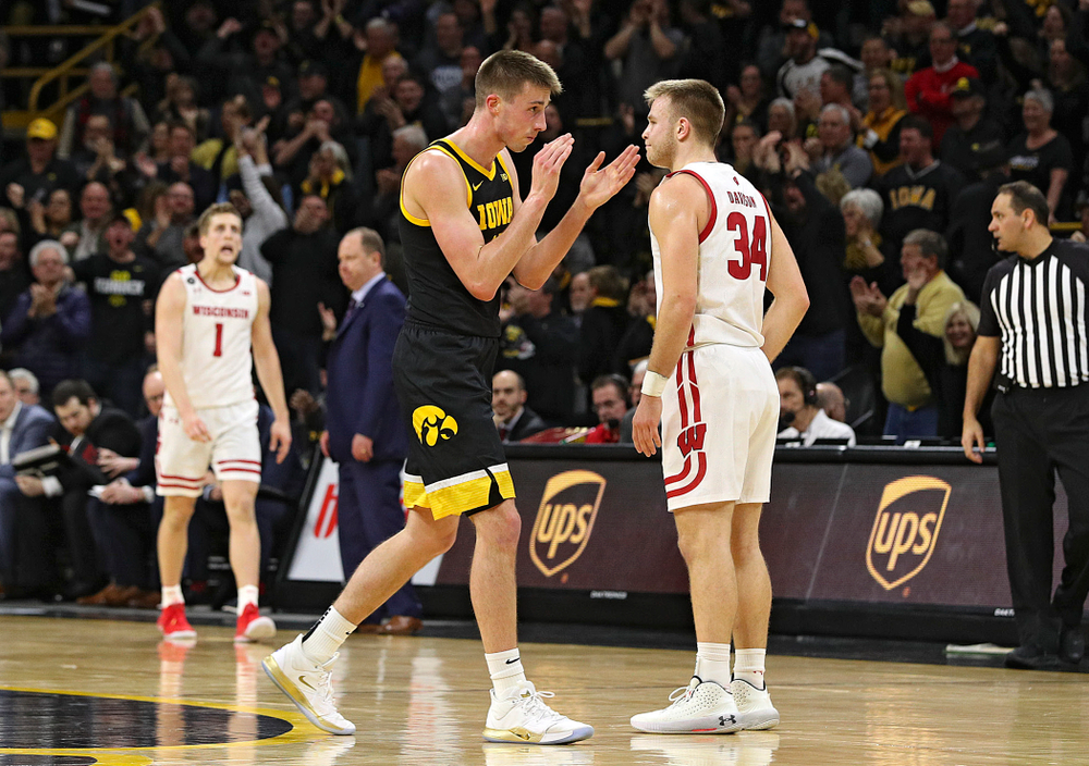 Iowa Hawkeyes guard Joe Wieskamp (10) claps as he walks back to the bench for a timeout during the second half of their game at Carver-Hawkeye Arena in Iowa City on Monday, January 27, 2020. (Stephen Mally/hawkeyesports.com)