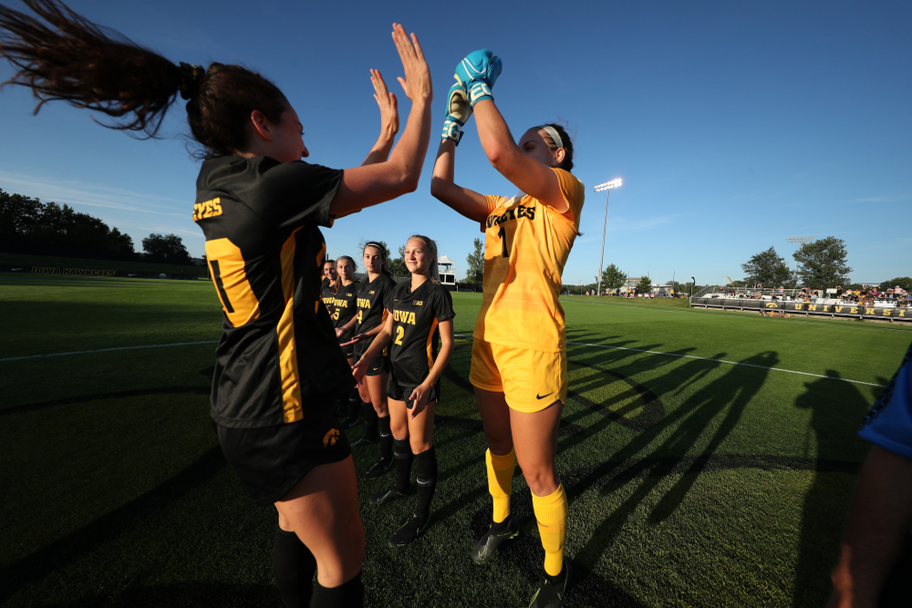 Iowa Hawkeyes forward Devin Burns (30) and goalkeeper Claire Graves (1) against Western Michigan Thursday, August 22, 2019 at the Iowa Soccer Complex. (Brian Ray/hawkeyesports.com)