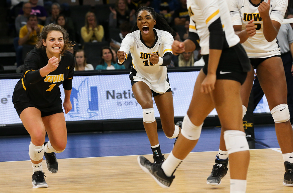 Iowa Hawkeyes defensive specialist Molly Kelly (1) and Iowa Hawkeyes outside hitter Taylor Louis (16) react after winning a point during a game against Purdue at Carver-Hawkeye Arena on October 13, 2018. (Tork Mason/hawkeyesports.com)