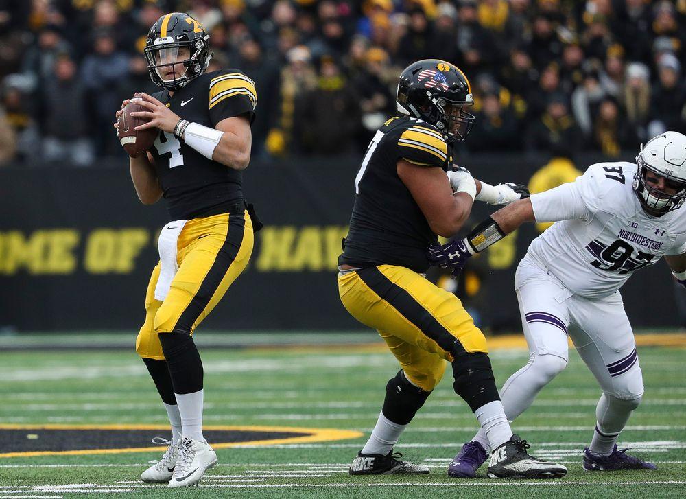 Iowa Hawkeyes quarterback Nate Stanley (4) drops back to pass during a game against Northwestern at Kinnick Stadium on November 10, 2018. (Tork Mason/hawkeyesports.com)