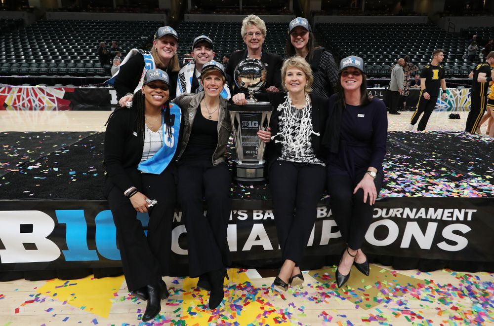 The Iowa Women's Basketball Coaching Staff with deputy athletics director Barbara Burke against the Maryland Terrapins Sunday, March 10, 2019 at Bankers Life Fieldhouse in Indianapolis, Ind. (Brian Ray/hawkeyesports.com)