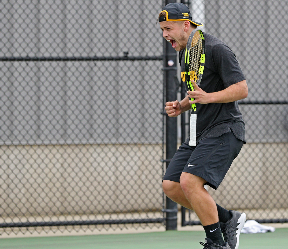 Iowa's Will Davies celebrates as he competes during a match against Ohio State at the Hawkeye Tennis and Recreation Complex in Iowa City on Sunday, Apr. 7, 2019. (Stephen Mally/hawkeyesports.com)