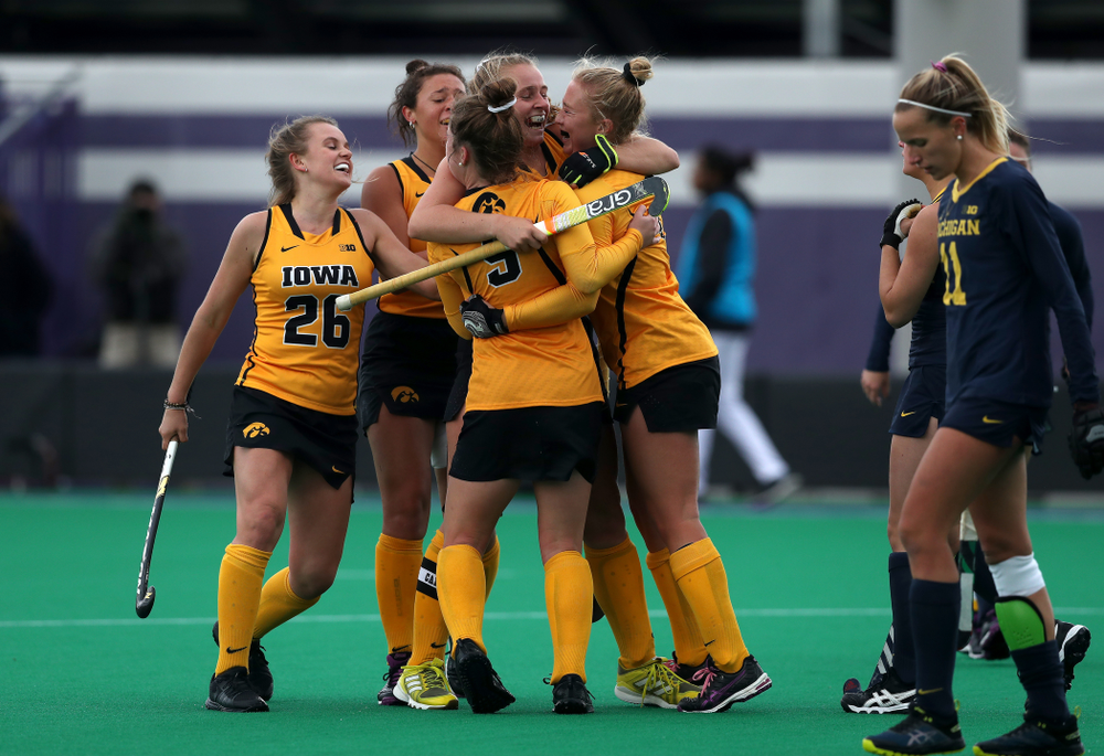 Iowa Hawkeyes Katie Birch (11) and Makenna Grewe (4) celebrate the game winning goal against the Michigan Wolverines in the semi-finals of the Big Ten Tournament Friday, November 2, 2018 at Lakeside Field on the campus of Northwestern University in Evanston, Ill. (Brian Ray/hawkeyesports.com)