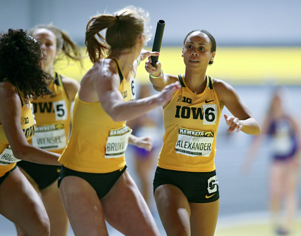 Iowa's Anaya Alexander (right) hands the baton off to Mariel Bruxvoort as they run the women's 1600 meter relay event during the Hawkeye Invitational at the Recreation Building in Iowa City on Saturday, January 11, 2020. (Stephen Mally/hawkeyesports.com)