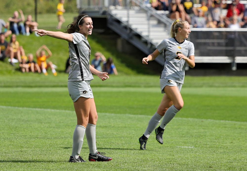 Iowa forward Kaleigh Haus (4) points after scoring a goal during the first half of their match at the Iowa Soccer Complex in Iowa City on Sunday, Sep 1, 2019. (Stephen Mally/hawkeyesports.com)