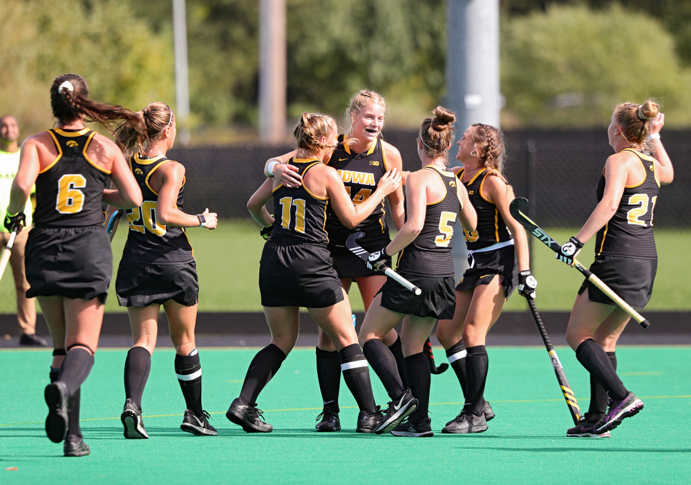 Iowa's Lokke Stribos (14) celebrates with teammates after scoring a goal during the first quarter of their match at Grant Field in Iowa City on Friday, Oct 4, 2019. (Stephen Mally/hawkeyesports.com)