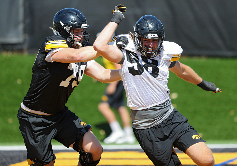 Iowa Hawkeyes defensive lineman Chris Reames (98) tries to ger around offensive lineman Jack Plumb (79) during Fall Camp Practice No. 7 at the Hansen Football Performance Center in Iowa City on Friday, Aug 9, 2019. (Stephen Mally/hawkeyesports.com)