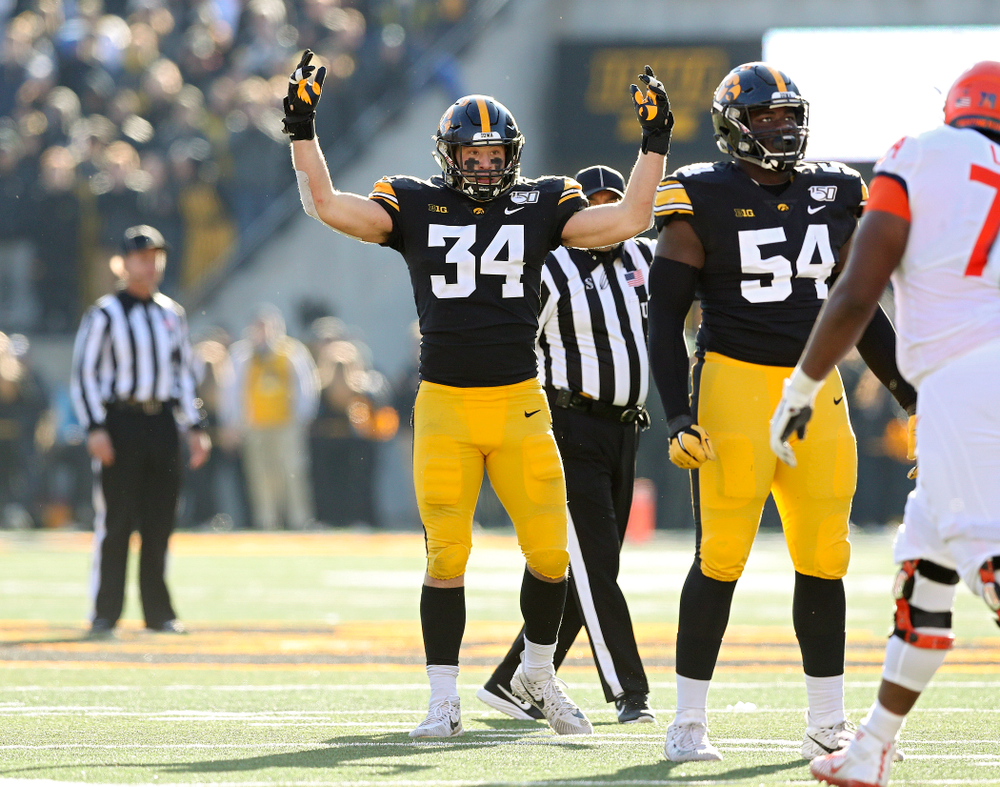 Iowa Hawkeyes linebacker Kristian Welch (34) pumps up the crowd during the fourth quarter of their game at Kinnick Stadium in Iowa City on Saturday, Nov 23, 2019. (Stephen Mally/hawkeyesports.com)