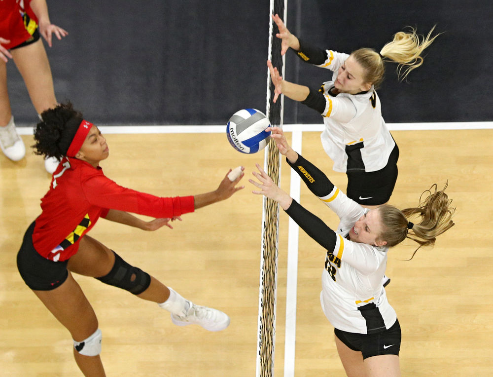 Iowa's Hannah Clayton (bottom) gets her hand on the ball as Kyndra Hansen tries to reach it during the second set of their match at Carver-Hawkeye Arena in Iowa City on Saturday, Nov 30, 2019. (Stephen Mally/hawkeyesports.com)