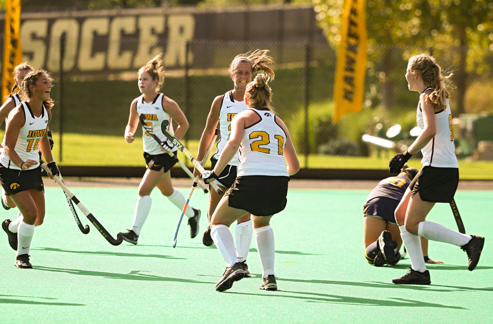 Iowa's Sophie Sunderland (20) celebrates her goal during the third quarter of their game at Grant Field in Iowa City on Friday, Sep 13, 2019. (Stephen Mally/hawkeyesports.com)