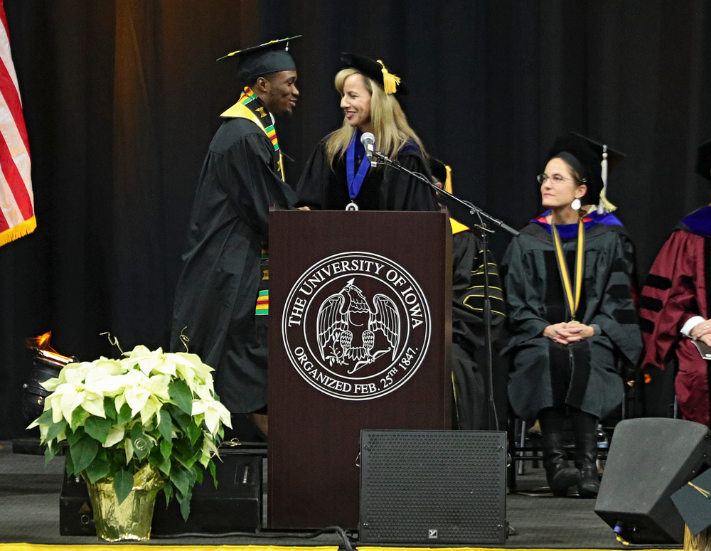 Iowa Track and Field's Karayme Bartley during the College of Liberal Arts and Sciences and University College Fall 2019 Commencement ceremony at Carver-Hawkeye Arena in Iowa City on Saturday, December 21, 2019. (Stephen Mally/hawkeyesports.com)