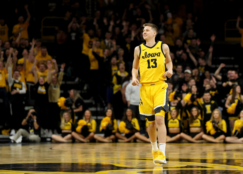 Iowa Hawkeyes guard Austin Ash (13) celebrates a three point basket against the Nebraska Cornhuskers Saturday, February 8, 2020 at Carver-Hawkeye Arena. (Brian Ray/hawkeyesports.com)