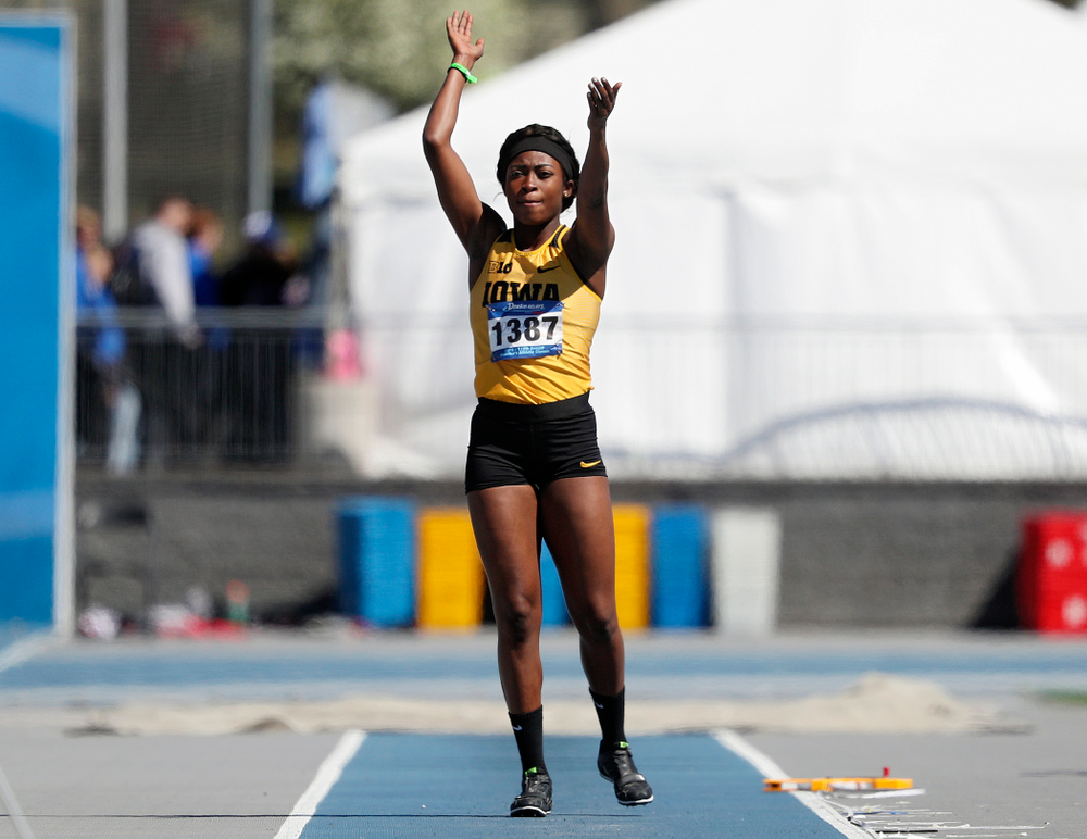 Iowa's Amanda Carty gets the crowd to clap before making a jump in the women's long jump event during the second day of the Drake Relays at Drake Stadium in Des Moines on Friday, Apr. 26, 2019. (Stephen Mally/hawkeyesports.com)