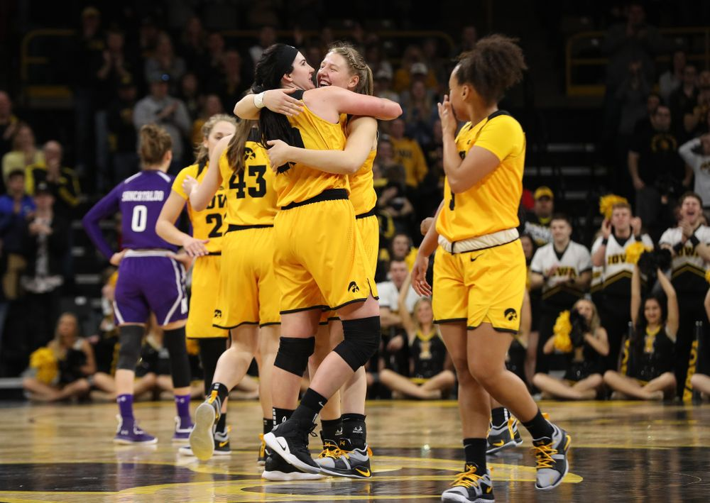 Iowa Hawkeyes forward Megan Gustafson (10) hugs center Monika Czinano (25) as she lives the court for the final time against the Northwestern Wildcats Sunday, March 3, 2019 at Carver-Hawkeye Arena. (Brian Ray/hawkeyesports.com)