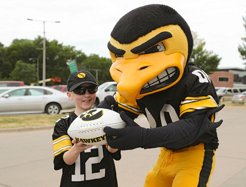 A young fan gets an autograph from Herky during Kids Day at Kinnick Stadium in Iowa City on Saturday, Aug 10, 2019. (Stephen Mally/hawkeyesports.com)