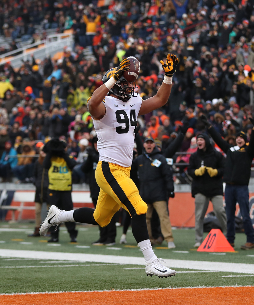 Iowa Hawkeyes defensive end A.J. Epenesa (94) scores after causeing and recovering a fumble against the Illinois Fighting Illini Saturday, November 17, 2018 at Memorial Stadium in Champaign, Ill. (Brian Ray/hawkeyesports.com)