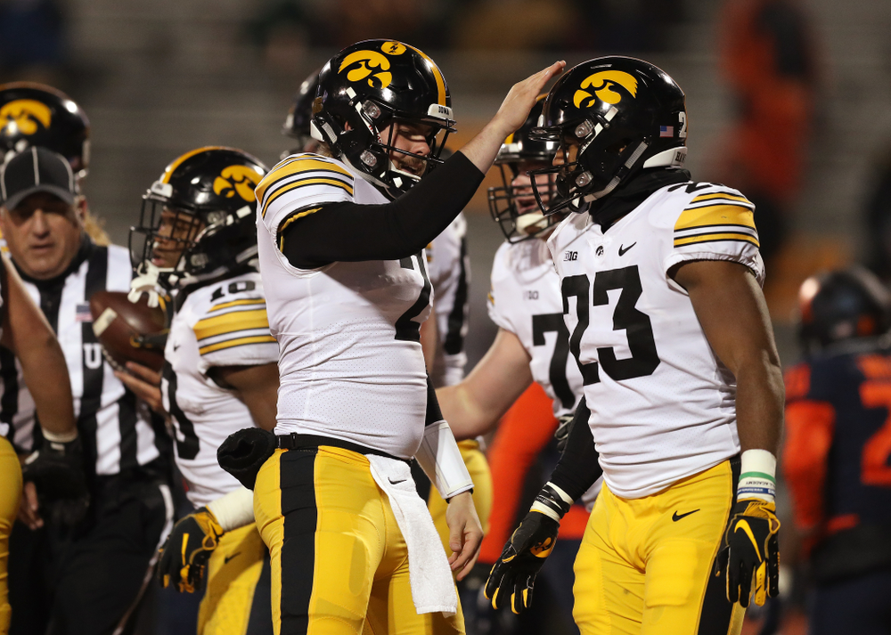Iowa Hawkeyes quarterback Peyton Mansell (2) and wide receiver Dominique Dafney (23) against the Illinois Fighting Illini Saturday, November 17, 2018 at Memorial Stadium in Champaign, Ill. (Brian Ray/hawkeyesports.com)