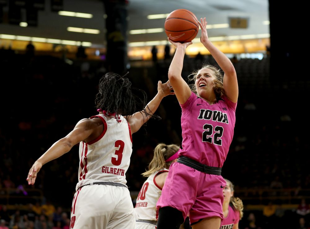 Iowa Hawkeyes guard Kathleen Doyle (22) pulls up for a shot against the Wisconsin Badgers Sunday, February 16, 2020 at Carver-Hawkeye Arena. (Brian Ray/hawkeyesports.com)