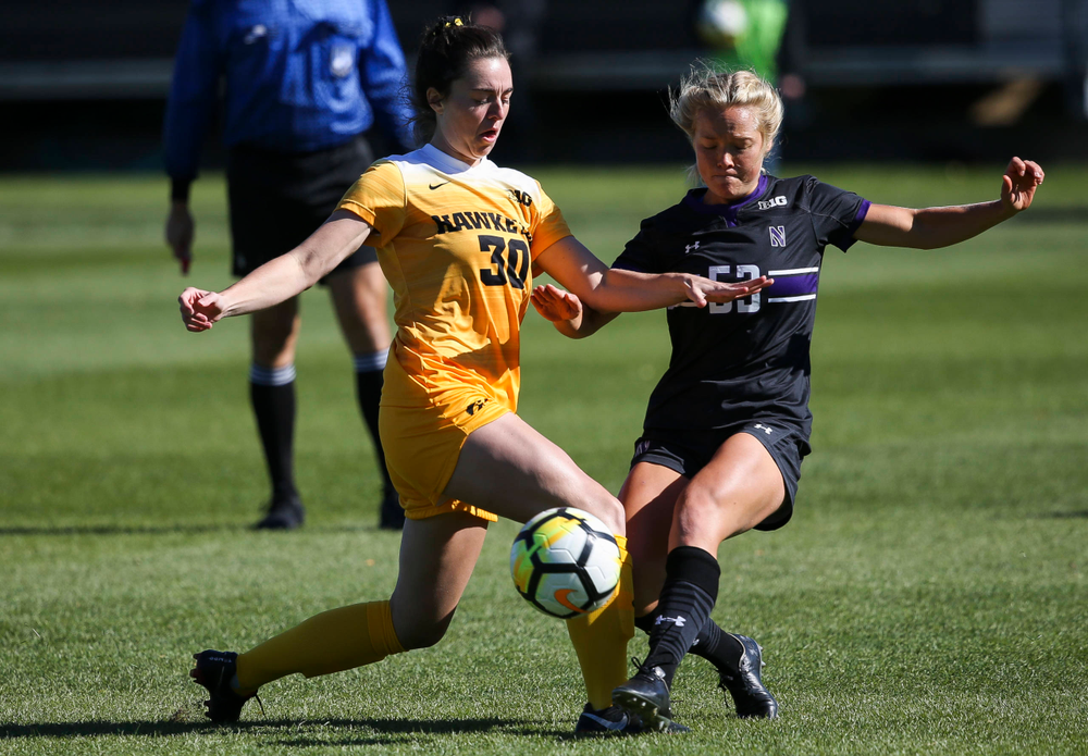Iowa Hawkeyes forward Devin Burns (30) makes a tackle during a game against Northwestern at the Iowa Soccer Complex on October 21, 2018. (Tork Mason/hawkeyesports.com)