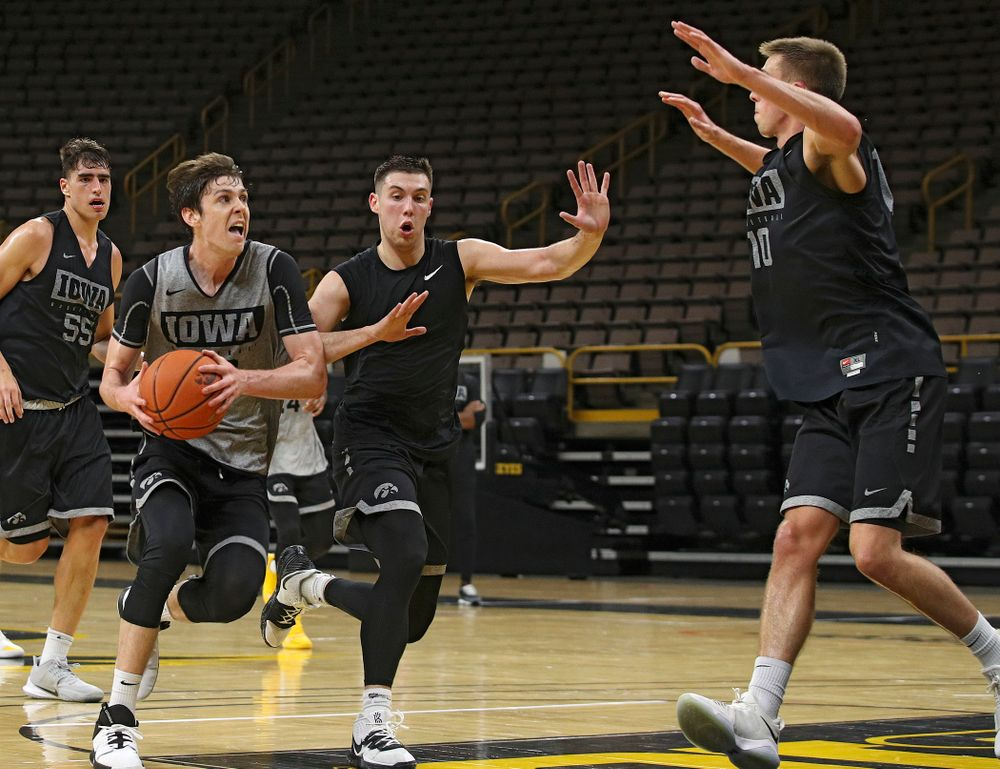 Iowa Hawkeyes forward Patrick McCaffery (22) looks to the basket as he drives in on guard CJ Fredrick (5) and guard Joe Wieskamp (10) during practice at Carver-Hawkeye Arena in Iowa City on Monday, Sep 30, 2019. (Stephen Mally/hawkeyesports.com)