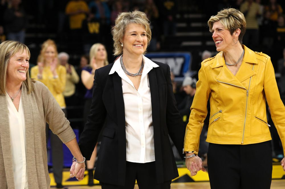 Iowa Hawkeyes head coach Lisa Bluder watches as her daughter Emma sings the National Anthem before the Iowa Hawkeyes game against the Northwestern Wildcats Sunday, March 3, 2019 at Carver-Hawkeye Arena. (Brian Ray/hawkeyesports.com)