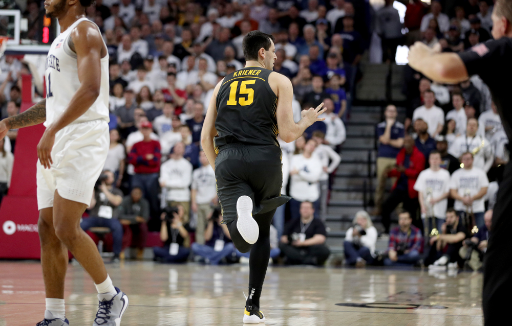 Iowa Hawkeyes forward Ryan Kriener (15) celebrates a three point basket against Penn State Friday, January 3, 2020 at the Palestra in Philadelphia. (Brian Ray/hawkeyesports.com)