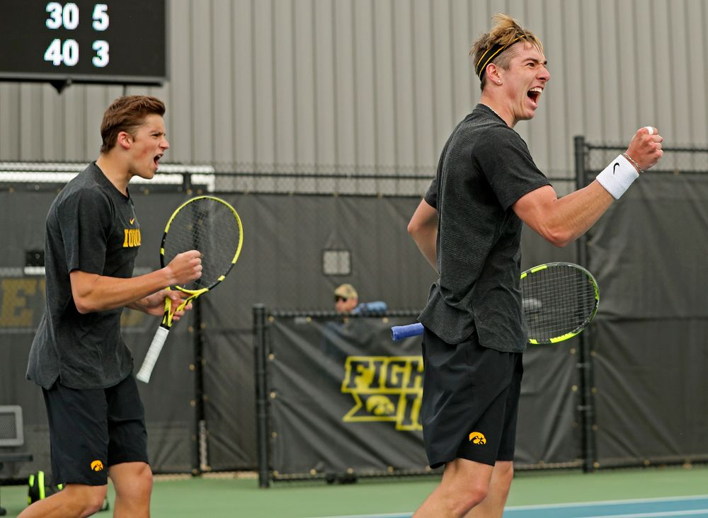 Iowa's Joe Tyler (from left) and Nikita Snezhko celebrate during a double match against Ohio State at the Hawkeye Tennis and Recreation Complex in Iowa City on Sunday, Apr. 7, 2019. (Stephen Mally/hawkeyesports.com)
