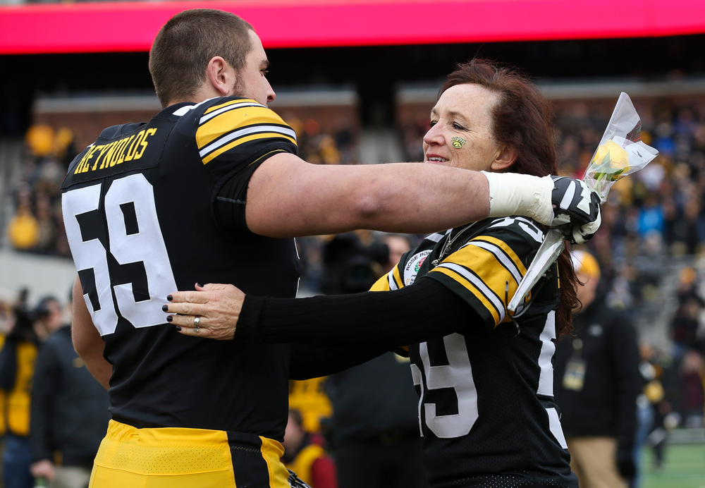 Iowa Hawkeyes offensive lineman Ross Reynolds (59) gets a hug from his mother during Senior Day ceremonies before a game against Nebraska at Kinnick Stadium on November 23, 2018. (Tork Mason/hawkeyesports.com)