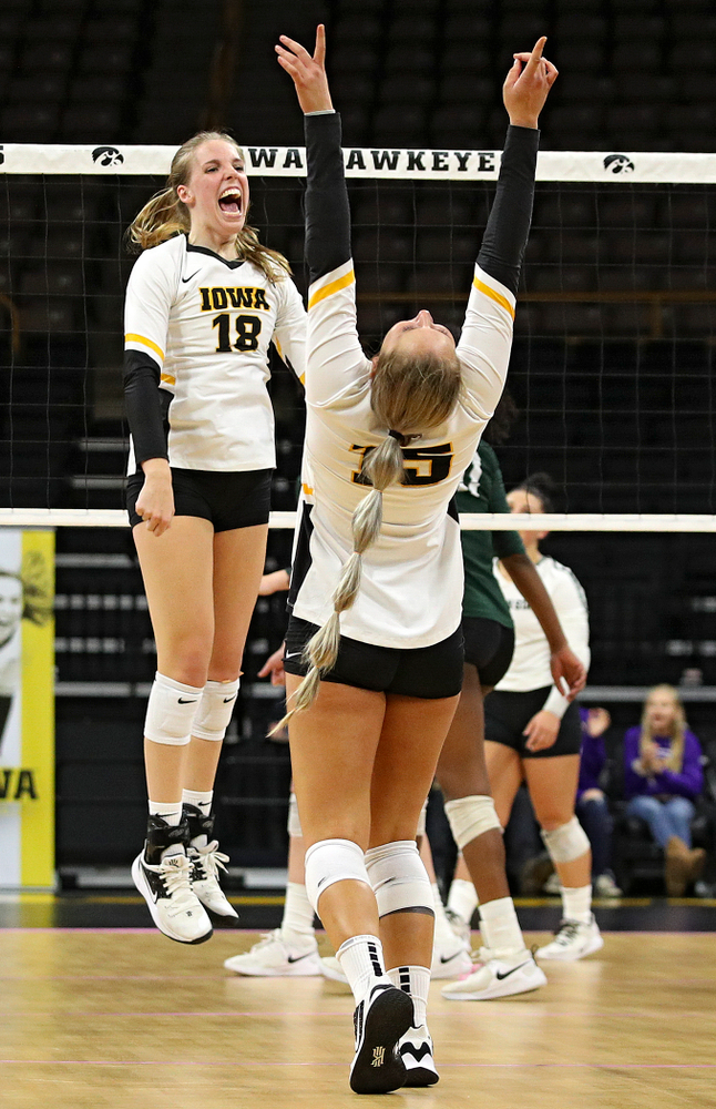Iowa's Hannah Clayton (18) and Maddie Slagle (15) celebrate a score during the fourth set of their volleyball match at Carver-Hawkeye Arena in Iowa City on Sunday, Oct 13, 2019. (Stephen Mally/hawkeyesports.com)