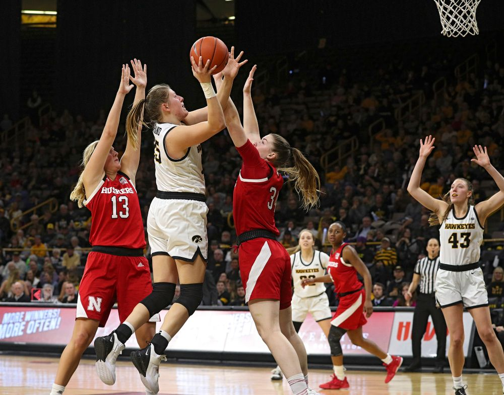 Iowa Hawkeyes forward Monika Czinano (25) puts up a shot during the fourth quarter of the game at Carver-Hawkeye Arena in Iowa City on Thursday, February 6, 2020. (Stephen Mally/hawkeyesports.com)
