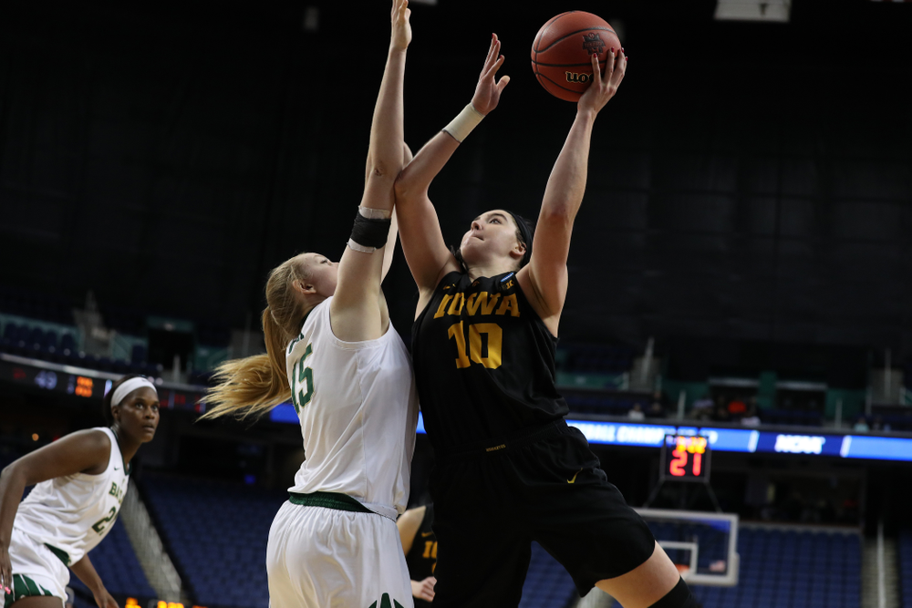 Iowa Hawkeyes forward Megan Gustafson (10) scores her 1,000th point of the year in the regional final against the Baylor Lady Bears in the 2019 NCAA Women's College Basketball Tournament Monday, April 1, 2019 at Greensboro Coliseum in Greensboro, NC.(Brian Ray/hawkeyesports.com)
