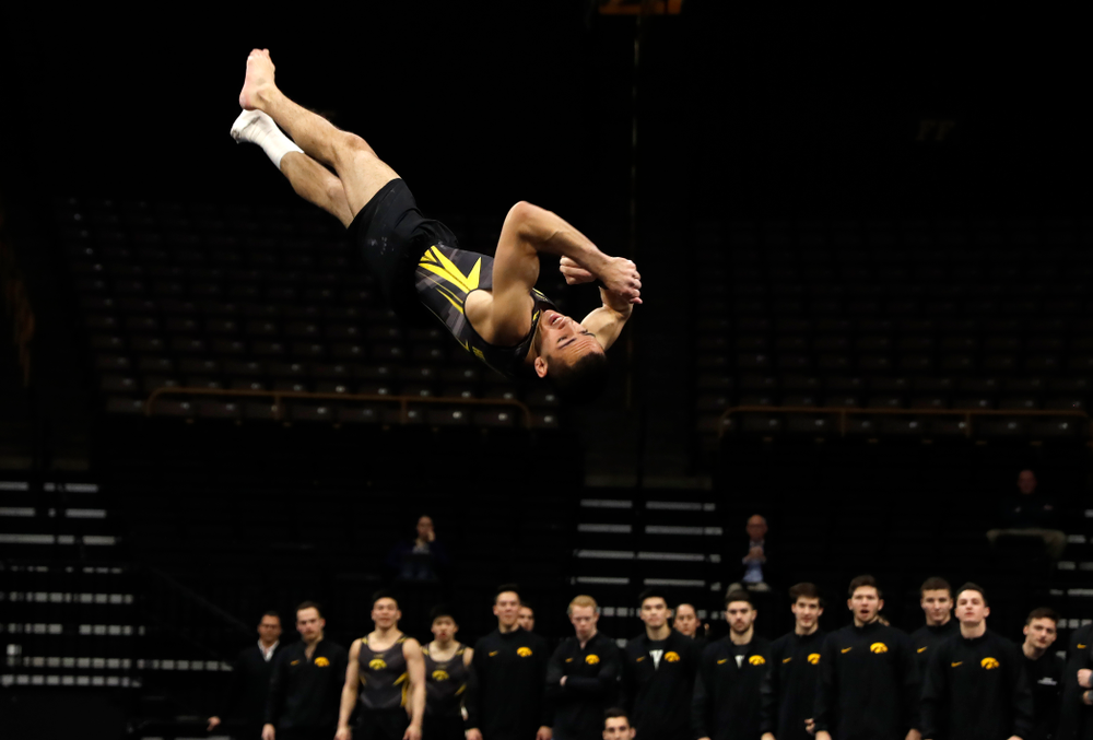 Andrew Herrador competes on the floor against Minnesota and Air Force