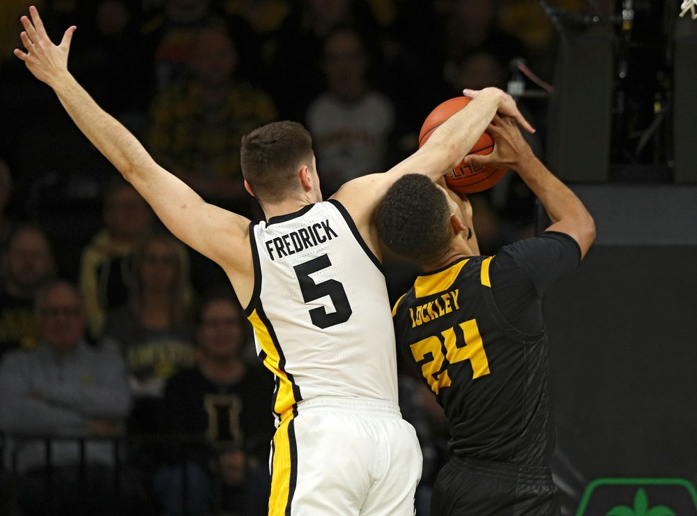 Iowa Hawkeyes guard CJ Fredrick (5) blocks a shot by Kennesaw State Owls forward Bryson Lockley (24) during the first half of their their game at Carver-Hawkeye Arena in Iowa City on Sunday, December 29, 2019. (Stephen Mally/hawkeyesports.com)