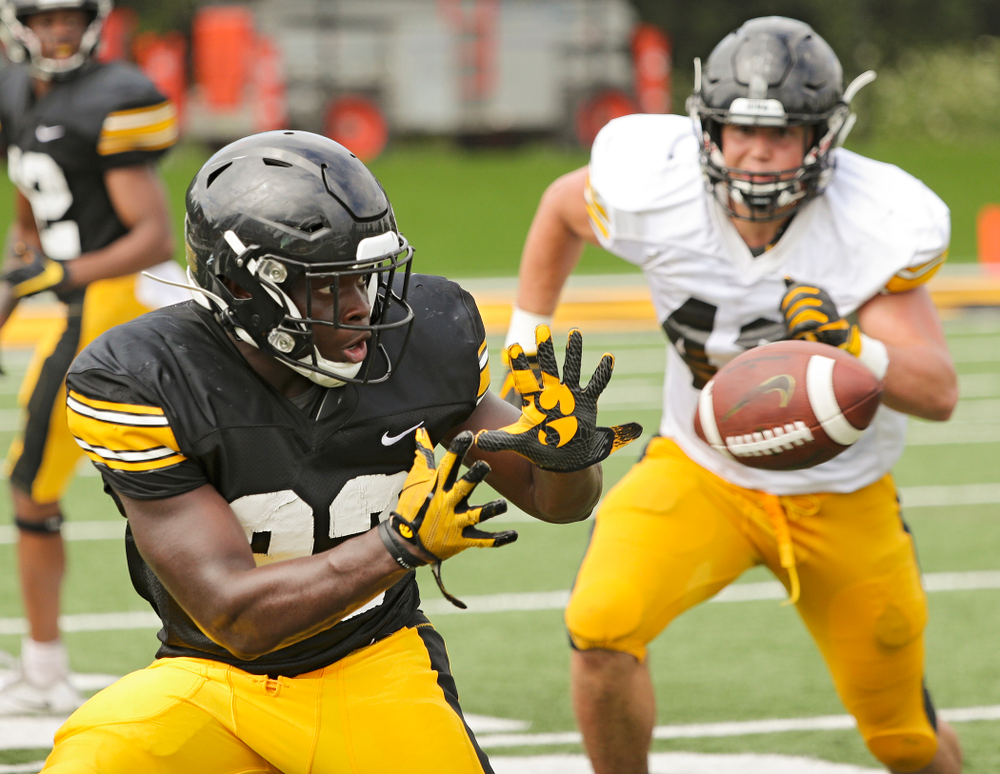 Iowa Hawkeyes running back Shadrick Byrd (23) pulls in a pass as linebacker Dillon Doyle (43) closes in during Fall Camp Practice No. 10 at the Hansen Football Performance Center in Iowa City on Tuesday, Aug 13, 2019. (Stephen Mally/hawkeyesports.com)
