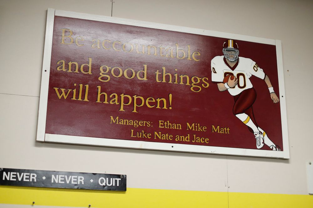 A sign created by Iowa Hawkeyes quarterback Nathan Stanley (4) and his fellow managers hangs in the weight room at his high school Wednesday, May 30, 2018 in Menomonie, Wisc. (Brian Ray/hawkeyesports.com)