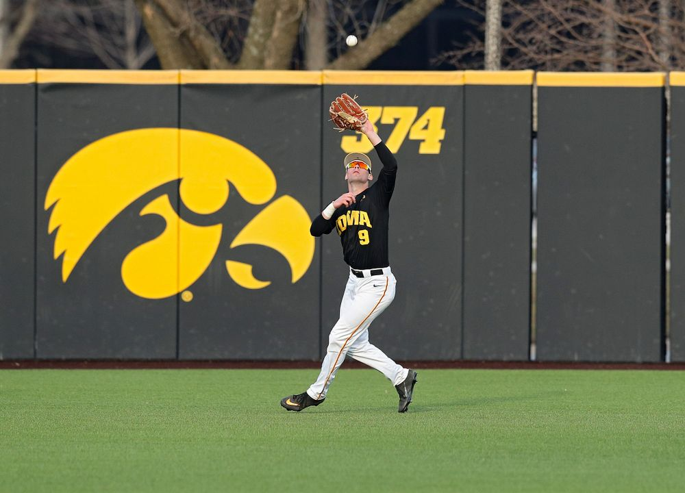 Iowa outfielder Ben Norman (9) pulls in a fly ball for an out during the seventh inning of their college baseball game at Duane Banks Field in Iowa City on Tuesday, March 10, 2020. (Stephen Mally/hawkeyesports.com)