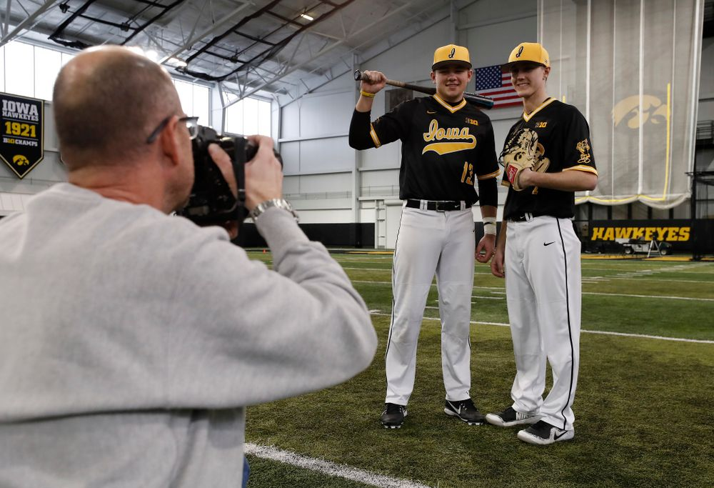 Iowa Hawkeyes catcher Matt Berst (13) and pitcher Zach Daniels (2) during the team's annual media day Thursday, February 8, 2018 in the indoor practice facility. (Brian Ray/hawkeyesports.com)