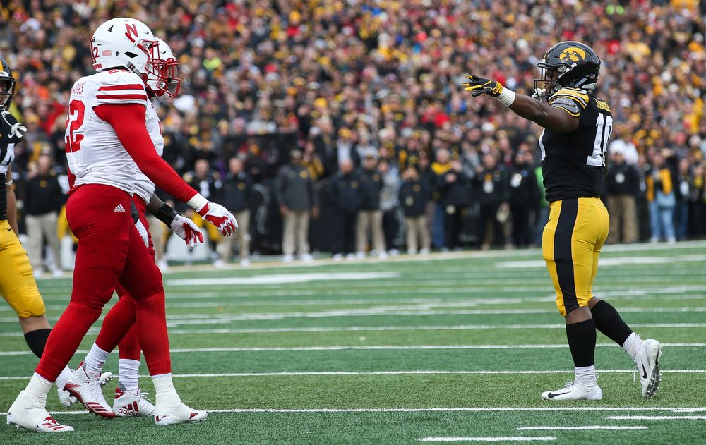 Iowa Hawkeyes running back Mekhi Sargent (10) signals for a first down